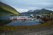 <h5>Satama vuonossa</h5><p>Eräs pienvenesatama Norjassa laskuveden aikaan auringin painuessa vuorien taakse. Tunnus: img: 4583</p>